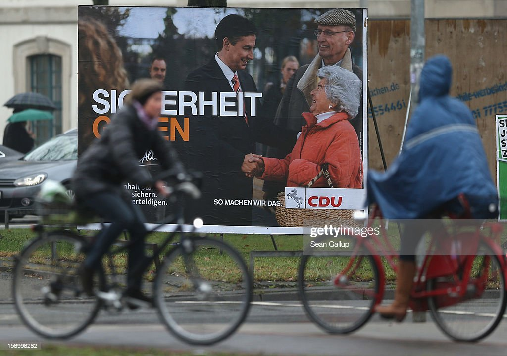 People on bicycles ride past an election campaign billboard featuring Lower Saxony Governor and incumbent candidate of the German Christian Democrats (CDU) David McAllister on January 5, 2013 in Hanover, Germany. Lower Saxony is holding state elections on January 20 and many analysts see the election as a bellwether for national elections scheduled to take place later this year.