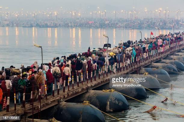 People on bridge over river, Allahabad, Uttar Pradesh, India