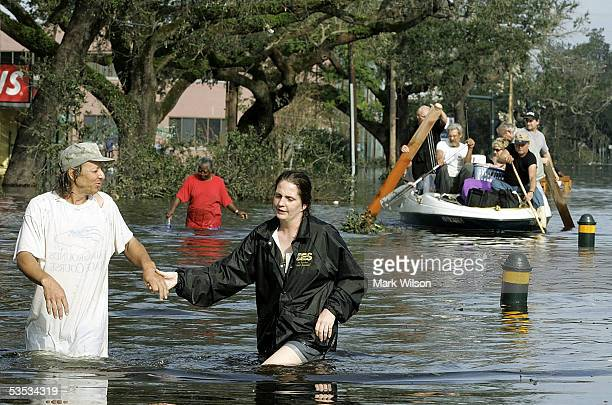 People on Canal street make their way to higher ground as water fills the streets August 30 2005 in New Orleans Louisiana Thousands of people are...