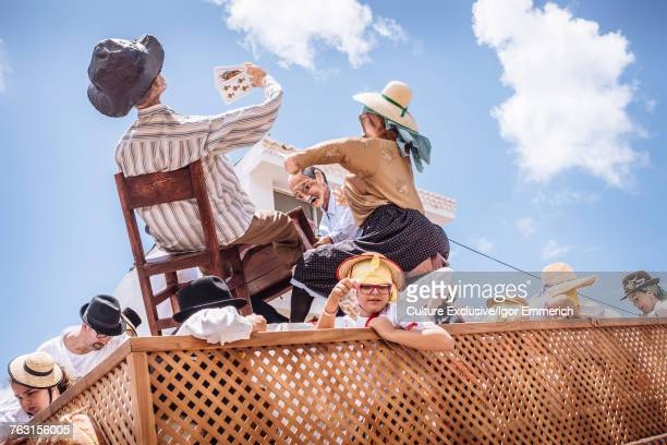 People on carnival float with effigies, Tegueste, Canary Islands, Spain