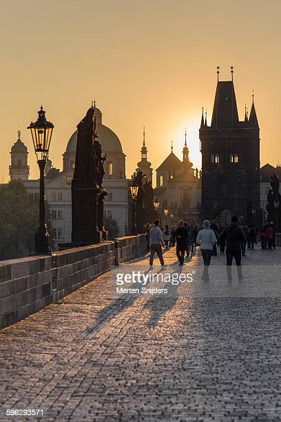 People on Charles Bridge in morning