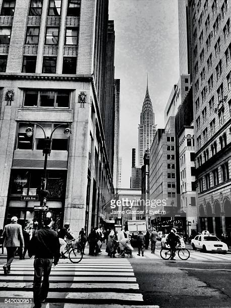 People On City Street Against Empire State Building