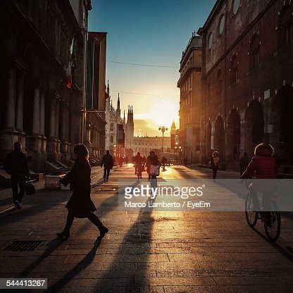 People On City Street At Sunset