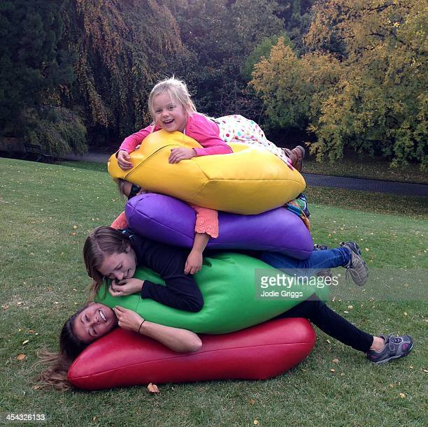 People on colorful bean bags stacked together