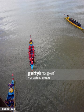 People On Dragon Boat In River