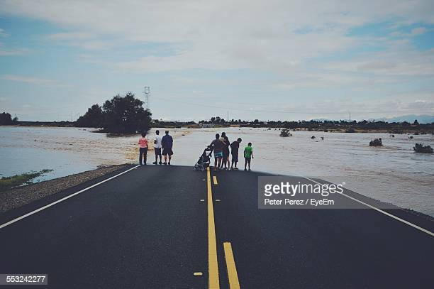 People On Flooded Highway