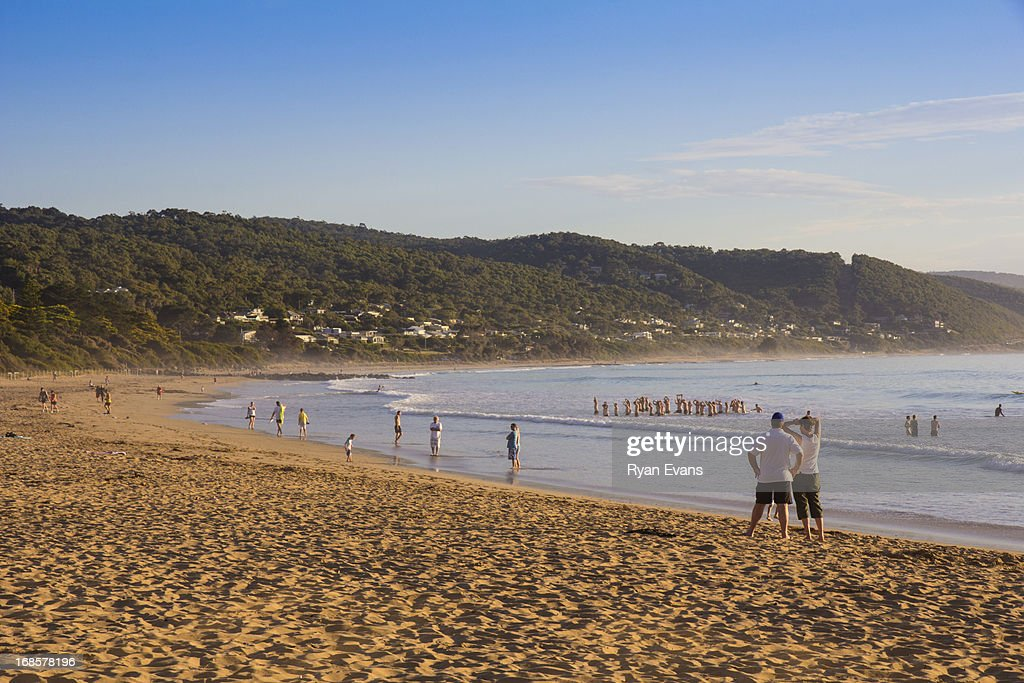 People on Lorne beach at sunrise