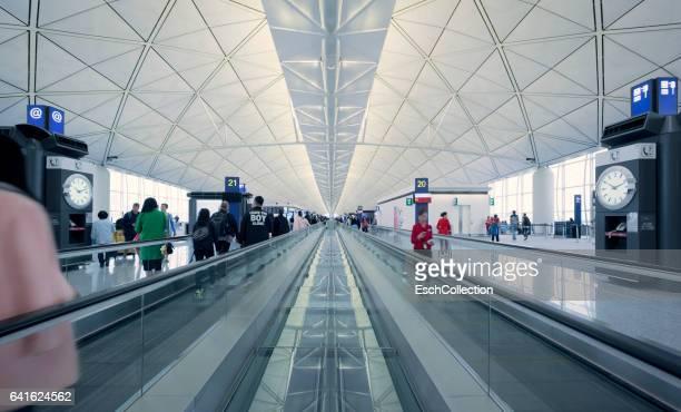 People on moving travelator at Hong Kong International Airport
