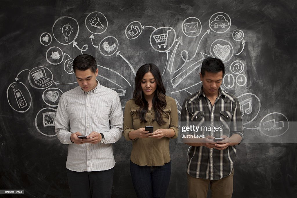 People on phones with social media icon chalkboard : Stock Photo