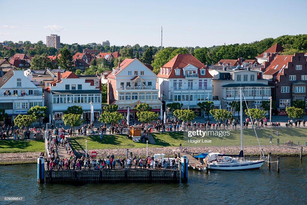 People on riverfront promenade