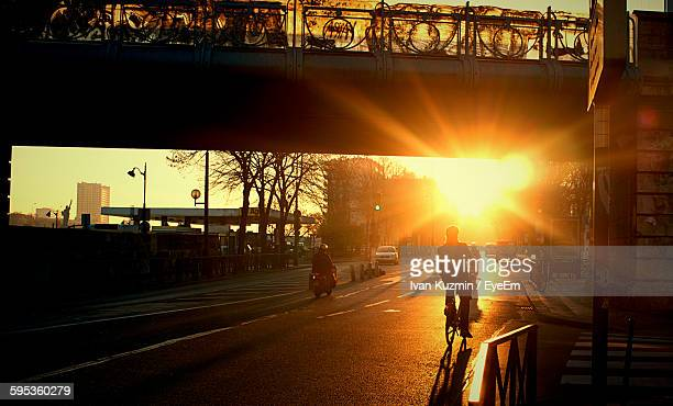 People On Road At Sunset