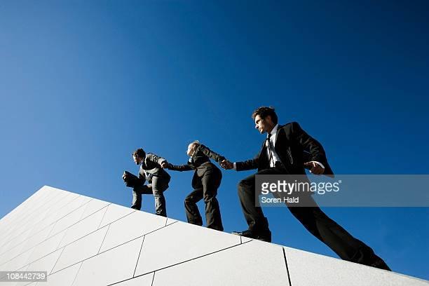 3 people on roof