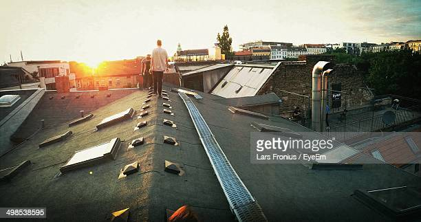 People on rooftop at sunset