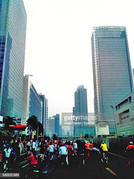 People On Street Amidst Skyscrapers