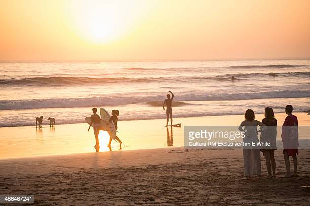 People on the beach at sunset, Taghazout, Morocco