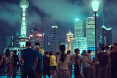 People on the bund overlooks Oriental Pearl Tower