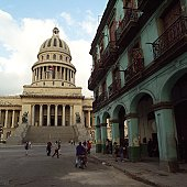 People on the street in front of the capitol building, Havana, Cuba