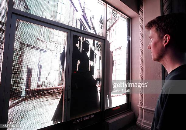 People on the street interact with the Victorian London window installation celebrating the premiere of 'Penny Dreadful' on Showtime at The Roosevelt...