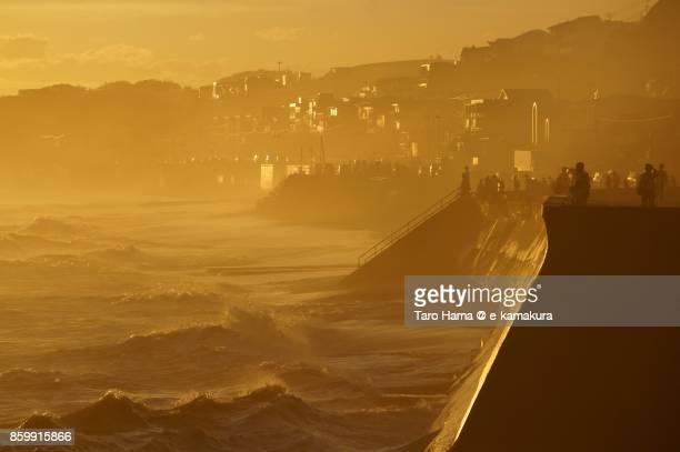 People on the sunset beach in Kamakura city in Kanagawa prefecture in Japan