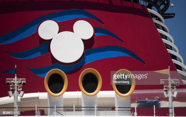 People on top of a float slide through a tubular water slide on the Disney Dream cruise ship at Port Canaveral in Cape Canaveral Florida US on...