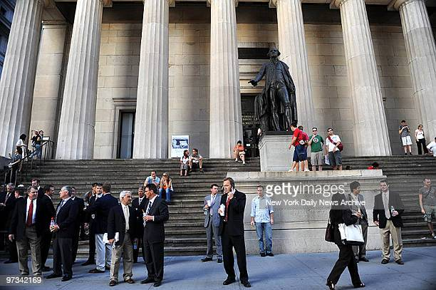 People on Wall street by the NY stock Exchange on day that Lehman Bros goes out of business
