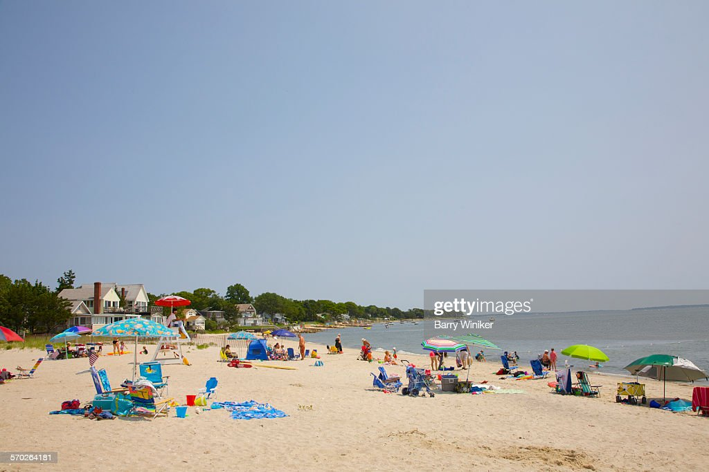 People on white sand beach, Jamesport, NY
