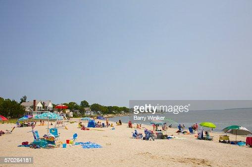 People on white sand beach, Jamesport, NY