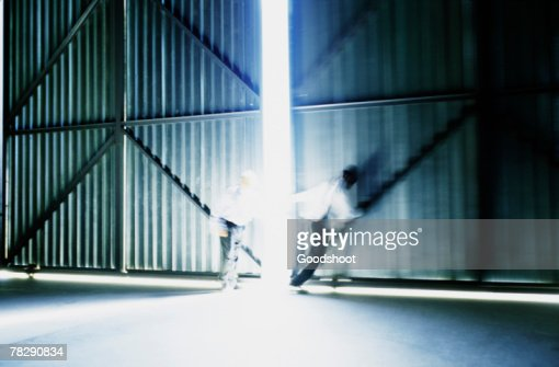 People Opening Doors : People opening doors to warehouse stock photo getty images