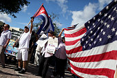 People opposed to US President Barack Obama's announcement earlier in the week of a change to the United States Cuba policy stand together at Jose...