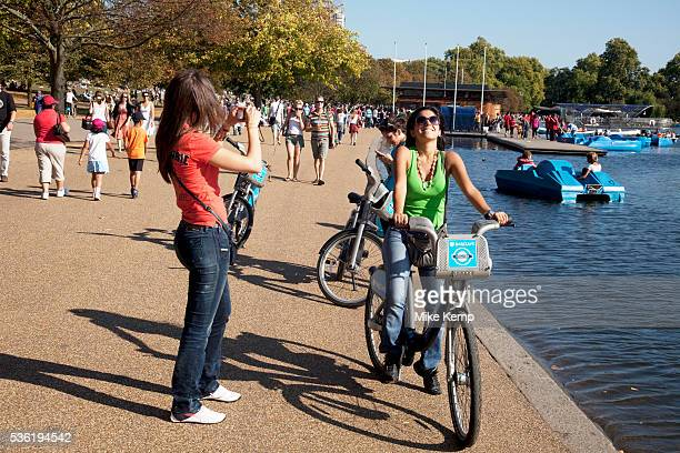 People out enjoying the unseasonally hot weather beside The Serpentine as a summertime heat wave hits London and the UK in what should be Autumn...