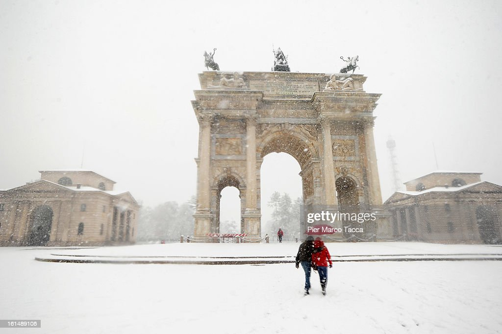 People out in the snow in Parco Sempione on February 11, 2013 in Milan, Italy.Wind, snow and tempetarture under zero over the country has affected regions from North Italy to South Italy, transports has been affected with train cancellations and road closures.Italy