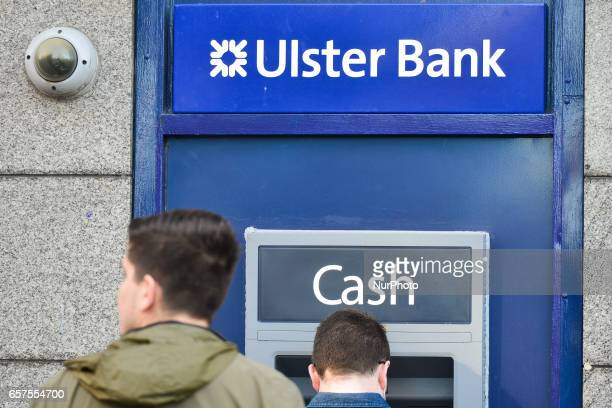 People outside a cash mashine in Dublin's city center Ulster Bank Chief Executive Gerry Mallon announced that Ulster Bank to close 22 branches in...