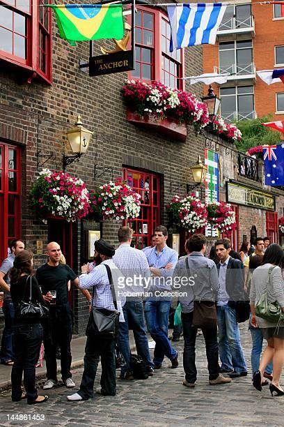 People Outside a London Pub
