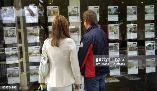 People outside an estate agent's window in London after the Chancellor announced that homes worth 175000 or less are to be exempted from stamp duty...