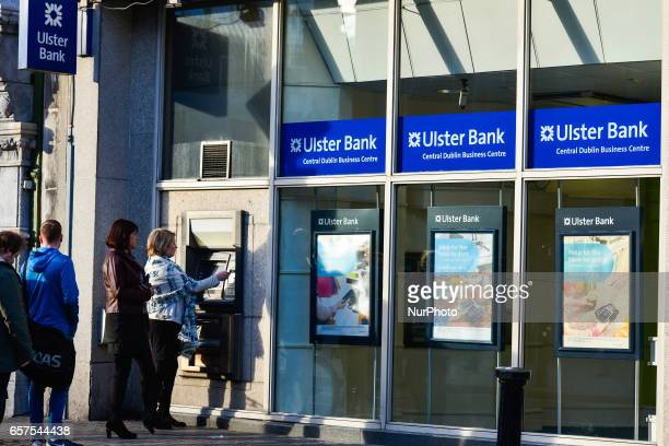 People outside an Ulster Bank cash mashine in Dublin's city center Ulster Bank Chief Executive Gerry Mallon announced that Ulster Bank to close 22...