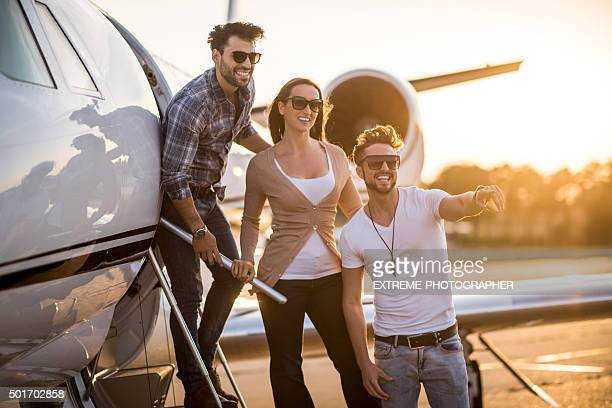 People outside the private jet airplane