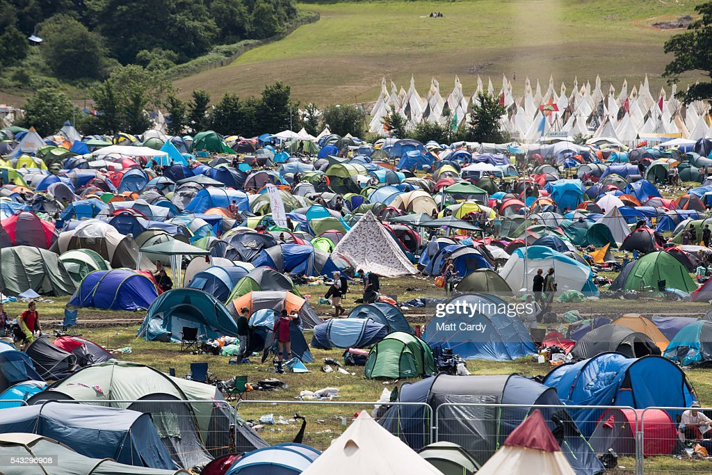 People pack away tents as festival goers leave the Glastonbury Festival 2016 at Worthy Farm, Pilton on June 26, 2016 near Glastonbury, England. The Festival, which Michael Eavis started in 1970 when several hundred hippies paid just £1, now attracts more than 175,000 people.