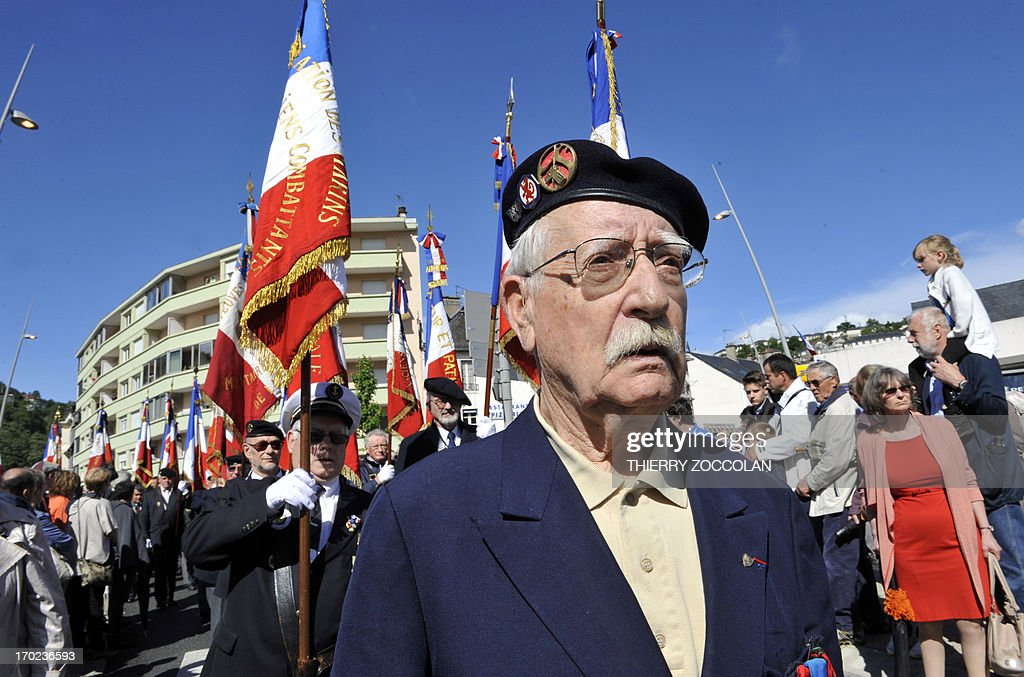 People parade during a ceremony in Tulle, central France, on June 9, 2013, to commemorate the Nazi massacre of Tulle in 1944.