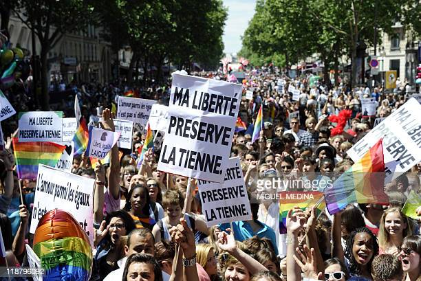 People parade during the 11th edition of the homosexual lesbian bisexual and transgender visibility march the Gay Pride on June 25 2011 in Paris...