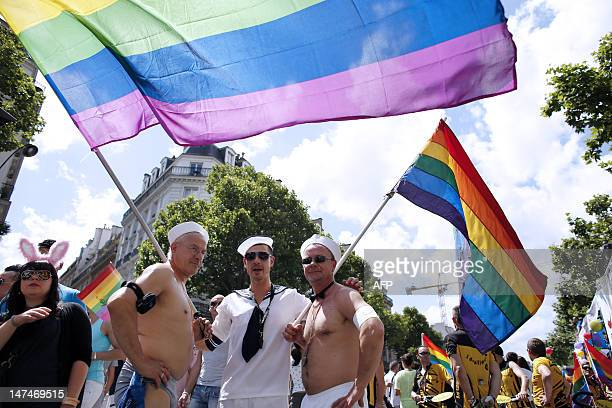 People parade during the 12th edition of the homosexual lesbian bisexual and transgender visibility march the Gay Pride on June 30 2012 in Paris...