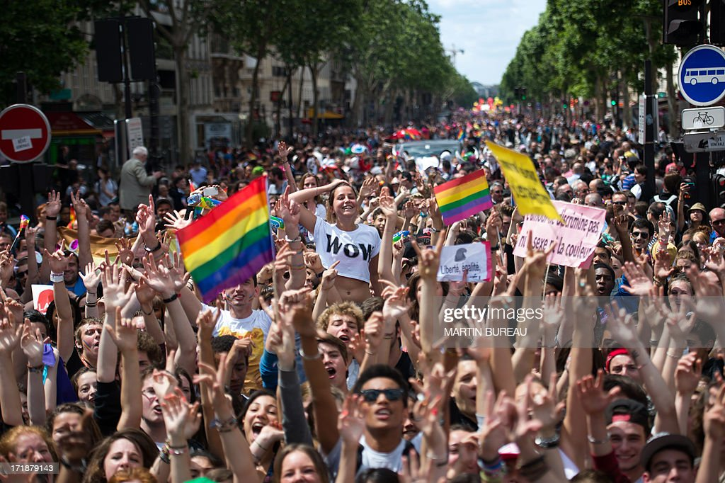 People parade during the homosexual, lesbian, bisexual and transgender (HLBT) visibility march, the Gay Pride, on June 29, 2013 in Paris. AFP PHOTO / MARTIN BUREAU