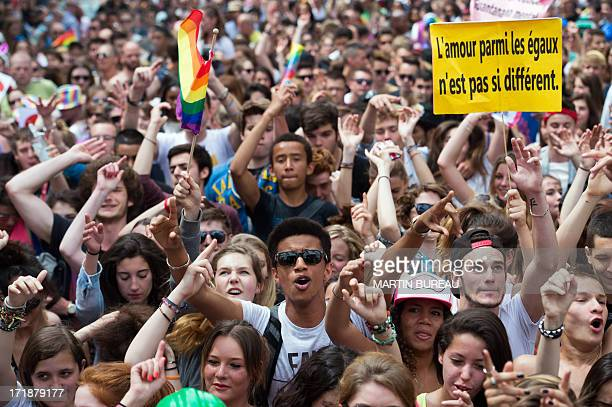 People parade during the homosexual lesbian bisexual and transgender visibility march the Gay Pride on June 29 2013 in Paris AFP PHOTO / MARTIN BUREAU