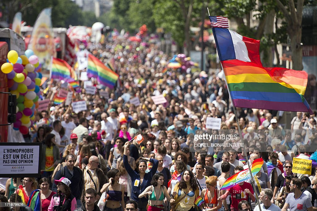 People parade during the homosexual, lesbian, bisexual and transgender (HLBT) visibility march, the Gay Pride, on June 29, 2013 in Paris. AFP PHOTO / LIONEL BONAVENTURE