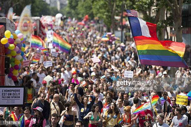 People parade during the homosexual lesbian bisexual and transgender visibility march the Gay Pride on June 29 2013 in Paris AFP PHOTO / LIONEL...