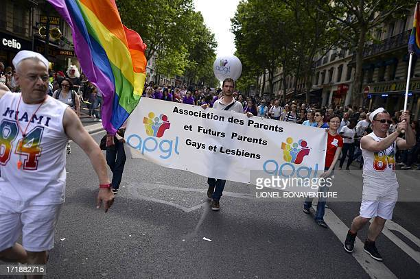 People parade during the homosexual lesbian bisexual and transgender visibility march the Gay Pride on June 29 2013 in Paris exactly one month after...