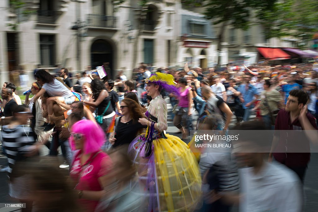 People parade during the homosexual, lesbian, bisexual and transgender (HLBT) visibility march, the Gay Pride, on June 29, 2013 in Paris, exactly one month to the day since France celebrated its first gay marriage. AFP PHOTO / MARTIN BUREAU