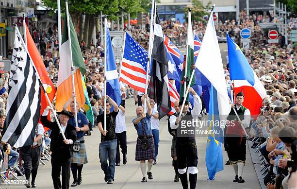 People parade holding flags of celtic nations on August 2 2009 in Lorient western France during the celtics nations Great Parade of the 'festival...