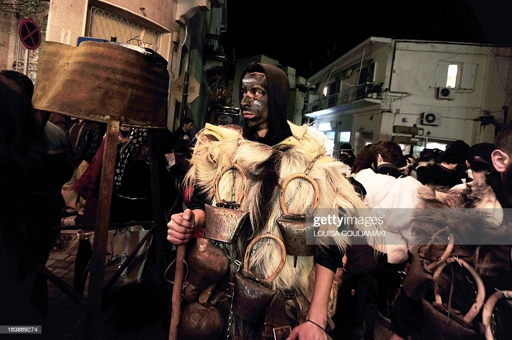 People parade in costumes as they celebrate the Night of the Ghosts carnival in the remote mountainous town of Amfissa in central Greece on March 16, 2013. Celebrations are in full swing on the Night of the Ghosts as townspeople, dressed as fairies, tanners and ghosts, pay homage to a decades-old tragic love story.AFP PHOTO / LOUISA GOULIAMAKI