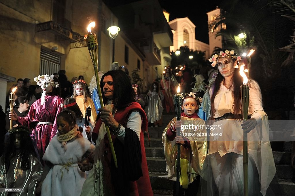 People parade in costumes as they celebrate the Night of the Ghosts carnival in the remote mountainous town of Amfissa in central Greece on March 16, 2013. Celebrations are in full swing on the Night of the Ghosts as townspeople, dressed as fairies, tanners and ghosts, pay homage to a decades-old tragic love story. AFP PHOTO / LOUISA GOULIAMAKI