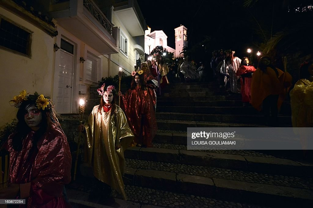 People parade in costumes as they celebrate the Night of the Ghosts carnival in the remote mountainous town of Amfissa in central Greece on March 16, 2013. Celebrations are in full swing on the Night of the Ghosts as townspeople, dressed as fairies, tanners and ghosts, pay homage to a decades-old tragic love story.